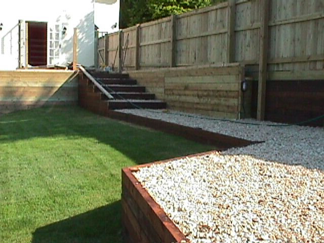 Terrace with steps and closeboard fence
